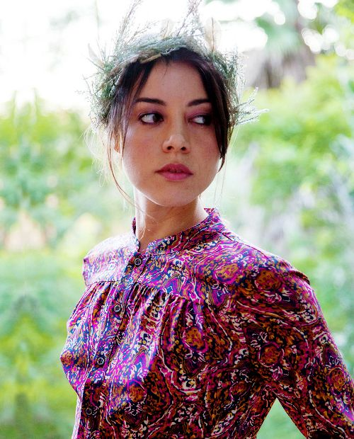 Aubrey Plaza photographed by Roger Davies. Patterned blouse. flowers in my hair. flower crown. red lipstick.