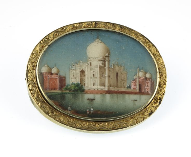 Lot 705, A 19th Century gold coloured oval brooch with painted Indian miniature scene of a temple, est  £100-200