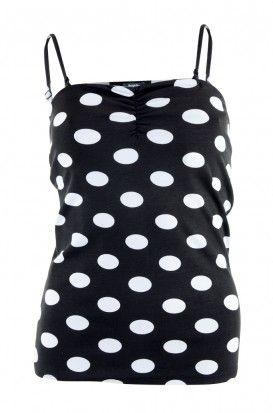 Zwart topje met witte bollen. http://www.bel-bo.be/zwarte-top-met-bollenprint-1314162.html