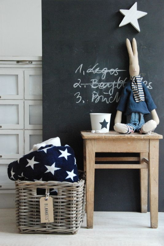 Buy a sheet of plywood, paint with chalkboard paint & prop it up against the wall!: