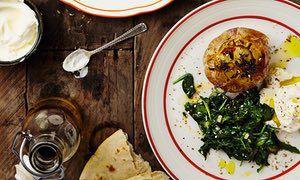 Thomasina Miers' roast new season garlic with labneh and herb salad