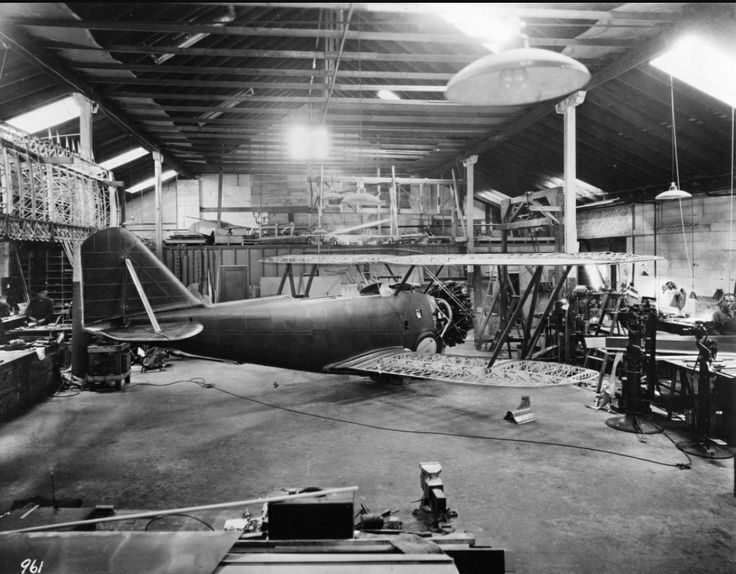 Grumman XFF-1 being assembled in the Baldwin garage. Shortly after this photo the plane was moved by truck to the new Curtiss Field location.
