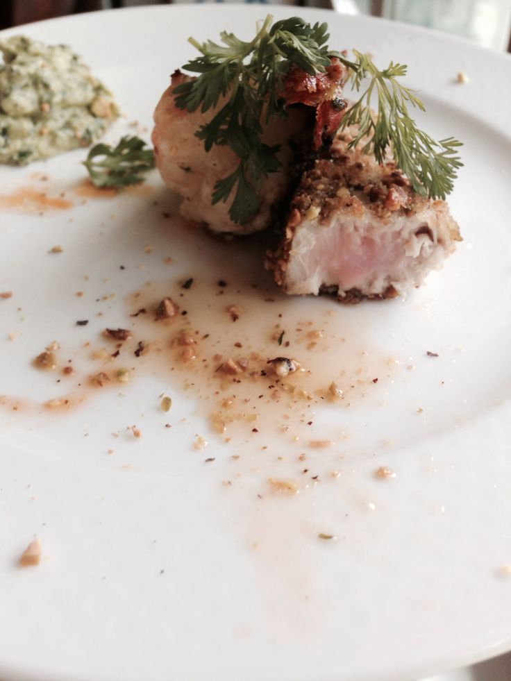 Pistachio crusted pan seared yellow fin tuna and cilantro lime shrimp with cilantro lime guacamole dipping sauce.