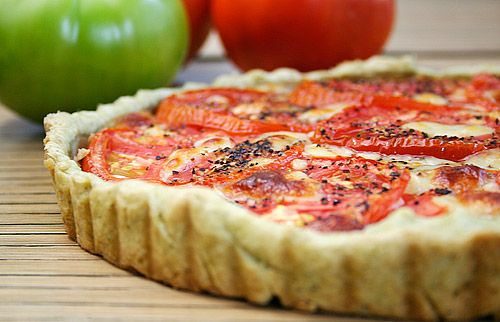 Fresh Tomato Tart with a Basil- Garlic Crust - one of my all time favorite recipes! Great for parties.