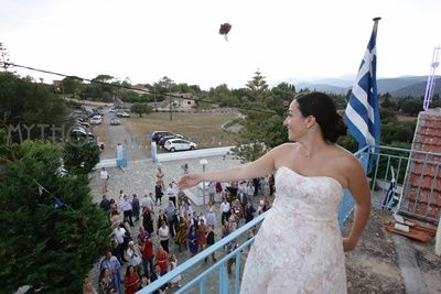 Throwing the bouquet - who is the next??? #weddings #weddingphotos #getmarriedingreece #weddinginkefalonia