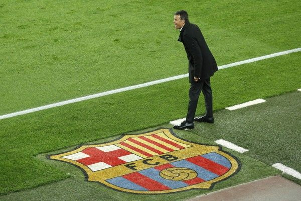 """Barcelona's coach Luis Enrique shouts from the sideline during the Spanish league """"Clasico"""" football match FC Barcelona vs Real Madrid CF at the Camp Nou stadium in Barcelona on April 2, 2016."""