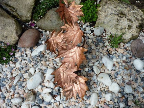 A handmade copper maple leaf fountain sculpture that would look equally at home in a pond or pebble pool. The fountain has a 10mm copper pipe entering from the side of a concrete base, which a plastic pipe can be attached to from the pump using jubilee clips (please note the pump is not included). I used a 600lph feature pump which provides an adequate flow to allow the water to drip from the leaves. The copper has been left untreated so it will change colour, gradually going darker as it…