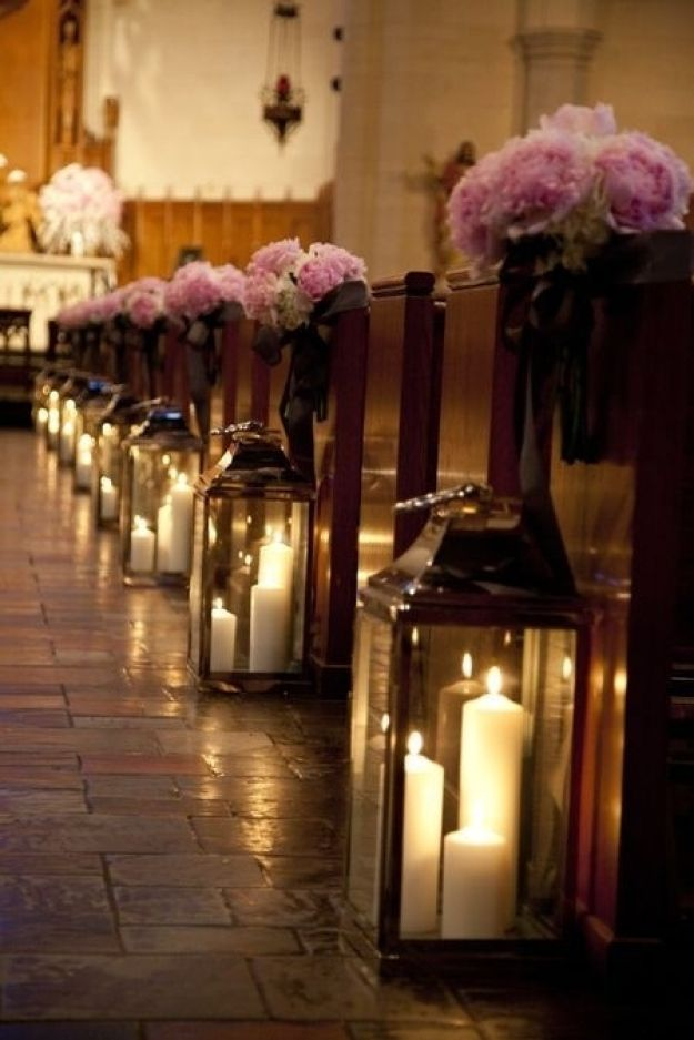 Candles in lanterns create a super romantic lighting effect for your ceremony.