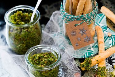 Fennel and paprika grissini with parsley and almond pesto