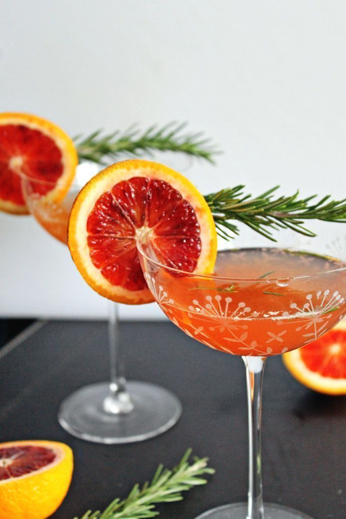 Blood orange rosemary gin cocktail. Homemade gin cocktail with blood orange bitters, fresh squeezed blood orange juice and fresh rosemary.