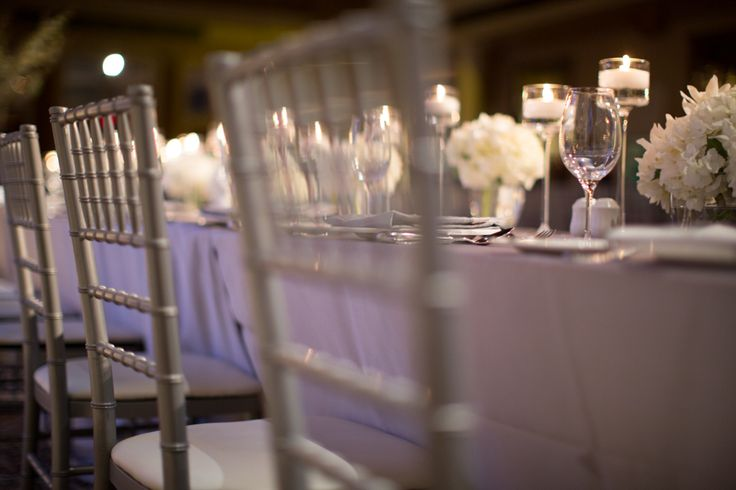 Liberty Grand wedding reception silver chairs with ivory flowers, love this combination!