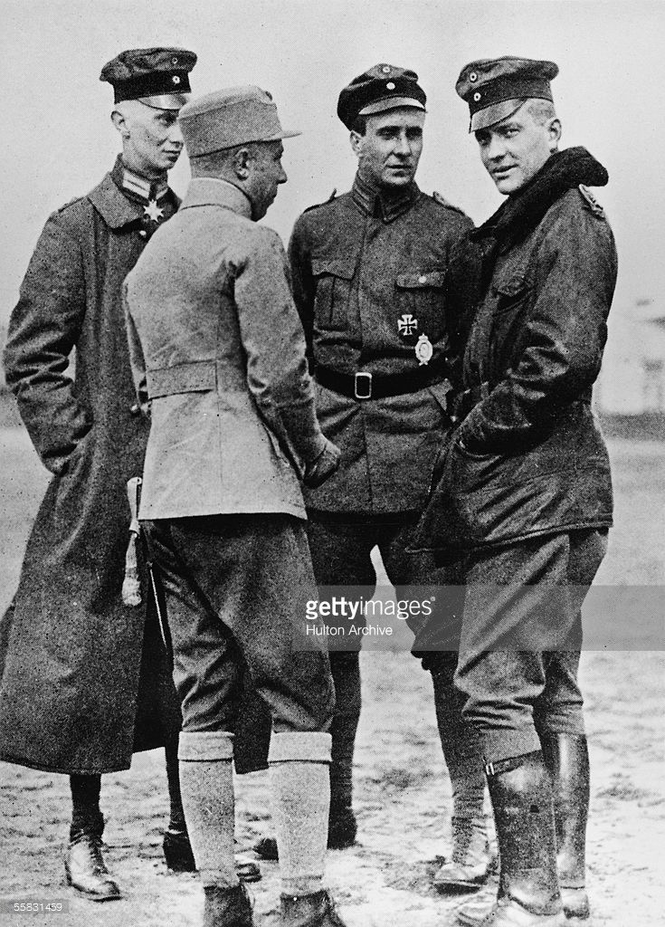 German flying ace Baron Manfred von Richthofen (1892 - 1918), right, talks to other German officers, 191Os. Von Richthofen, known as the Red Baron, is considered the most successful fighter pilot of all time, racking up 80 air combat battles in less than two years.
