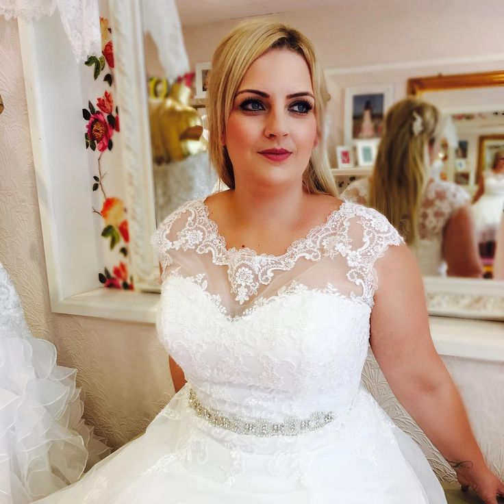 Here is a cap sleeve plus size bridal gown made with a beaded rhinestone & crystal belt.  The illusion neckline covers the bust. Bride can have custom plus size wedding dresses like this made at a reasonable price by our firm.  We also make #replicas of couture designs for brides who love a couture design but the price is out of their range.  We canmake a version with the same style & look for less.  Email for pricing at DariusCordell.com