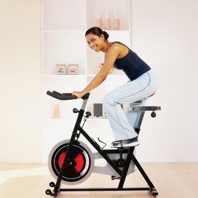 Riding a stationary bicycle is a common task during post-operative physical therapy.