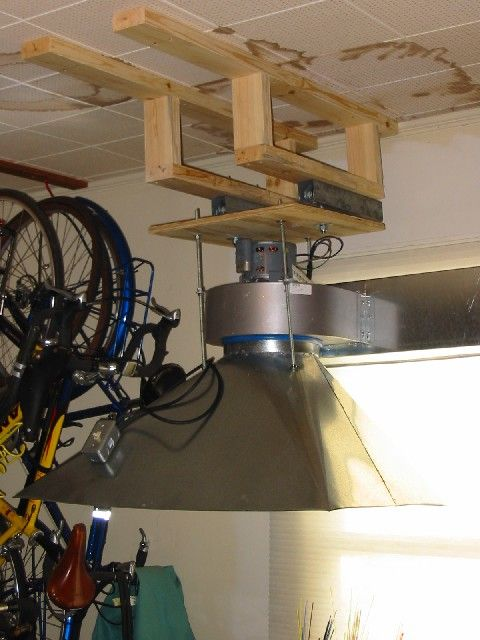 Squirrel Cage venting.  Ours would be inverted to draw down the particulate -- like a down draft.  Need to get a squirrel cage motor that is strong and with load rating so we can put a filter on it -- otherwise we will be losing things to the fan.