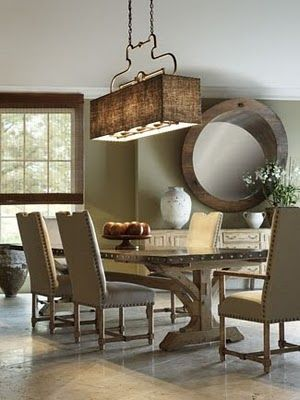 Linen chairs with nailhead detail, wood table and rectangular drum shade chandelier....awesome large circle mirror in background