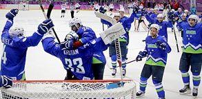 Image: Slovenia's hockey team celebrates after defeating Austria on Tuesday (© Mark Humphrey/AP)