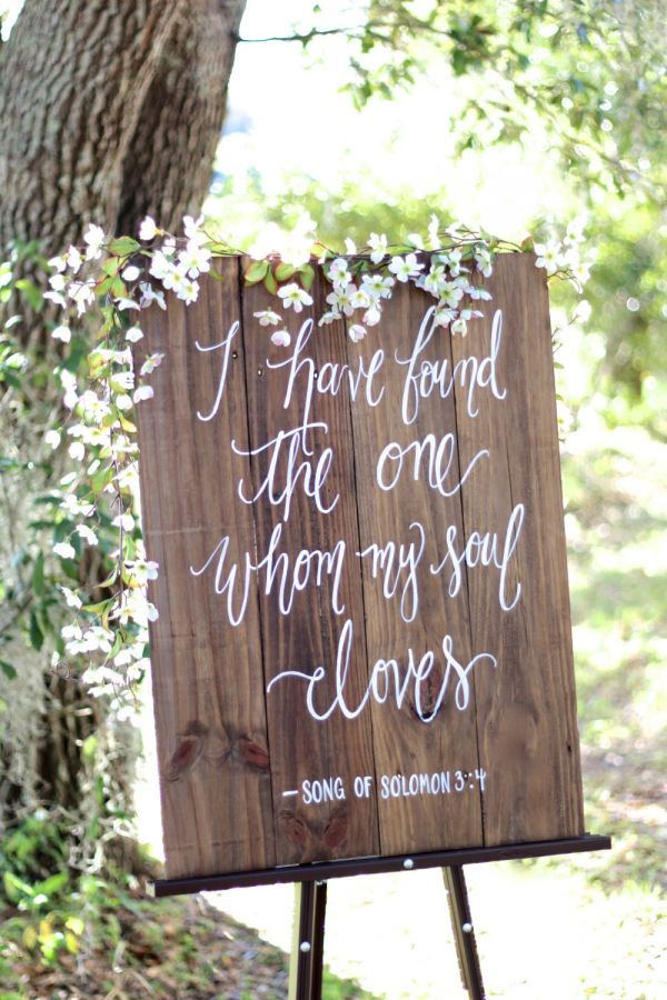 Customize this salvaged wood sign with the text of your choice. Each sign is stained with a walnut finish and calligraphed by hand. The grain of every piece is unique, with beautifully rustic notches and splits.