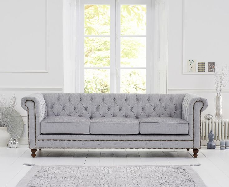 Malden Grey Fabric 3 Seater Sofa With Dark Ash Wood Legs (2 Cushions Included)  Sophisticated dark ash legs offer a beautiful contrast towards the grey upholstery.   https://www.bonsoni.com/malden-grey-fabric-3-seater-sofa-with-dark-ash-wood-legs-2-cushions-included
