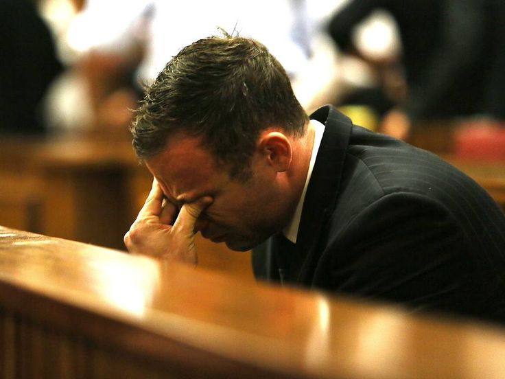 Oscar Pistorius reacts to the verdict in his murder trial at the High Court in Pretoria.