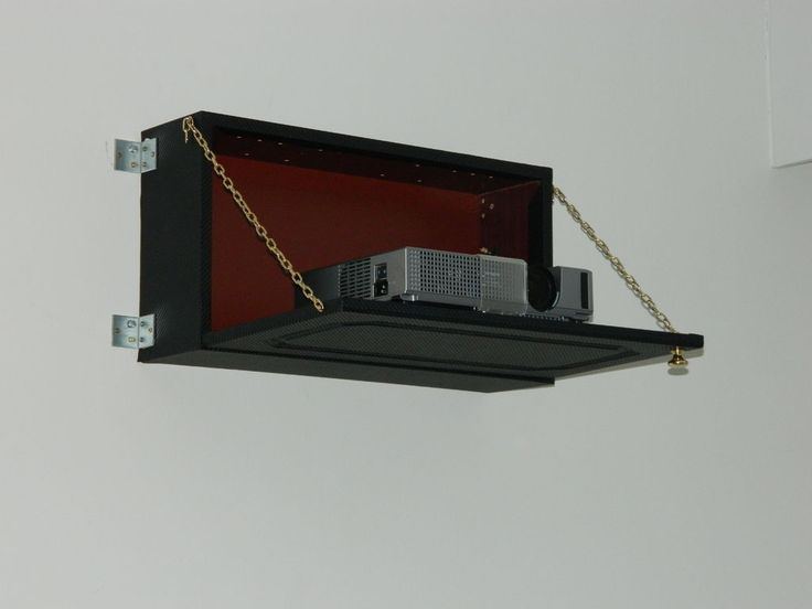 DIY Hidden video projector. There are several changes I would make. 1) ditch the carbon fiber look 2) mount to the wall rather than using hinges. 3) fixed hinge rather than chain. 4) possibly considering insetting in the wall itself.