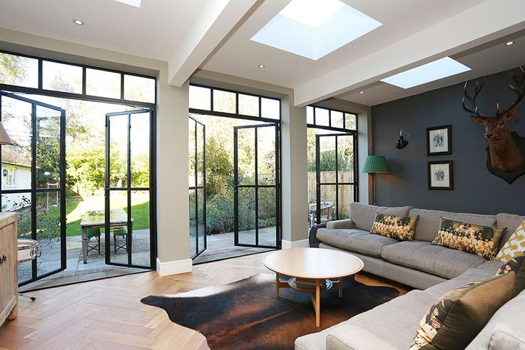 The substantial extension on this detached house features bespoke art deco style steel French doors which adds to the striking structural elements of the room.