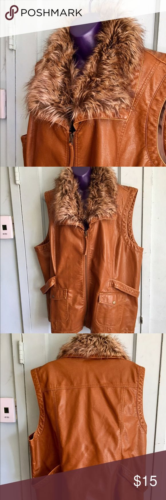 Brown faux leather vest with fake fur collar 3X Great vest to wear over a sweater or a jacket.  Pockets and buckles are functional. Dress Barn size 3X. Missing 2 buttons to attach the collar but it doesn't affect the look or function Dress Barn Jackets & Coats Vests