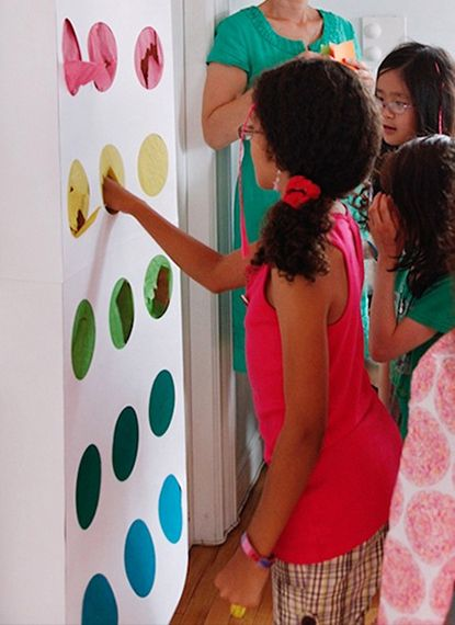 candy button | price is right punch party favor game. poster board, tissue paper, and paper bags taped to the back of each button.