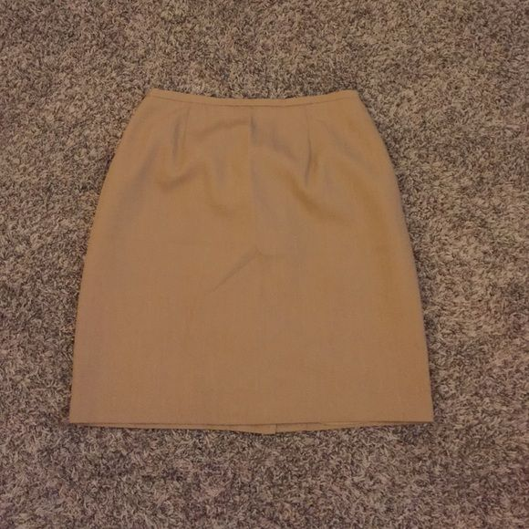 Mocha Brown Pencil Skirt Mocha brown Worthington pencil skirt. Size 14. Brand new without tags! Has a hidden zipper in the back. Also has a tiny silt in the back of the skirt Worthington Skirts Pencil