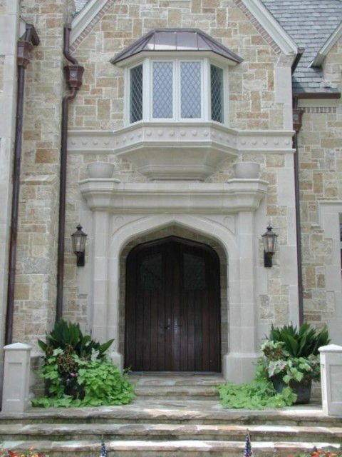 Tudor style manor house cast stone by american masonry for American brick and stone