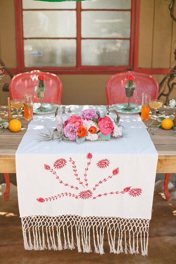 vintage Mexican textiles and blankets to set the table / http://www.himisspuff.com/colorful-mexican-festive-wedding-ideas/10/