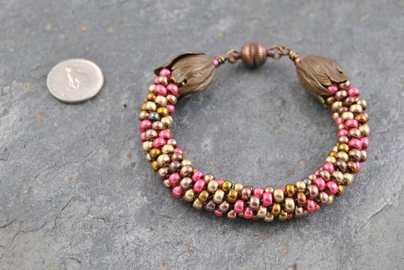 Metallic Miyuki Mix Kumihimo Artisan Bracelet #bracelet #kumihimo #kumihimobracelet #artisan #artisanbracelet #woven #handmade #knotted #handknotted #metallic #premium #quality #miyuki #miyukiseedbeads #seedbeads #copper #bronze #gold #pink #metallicmix #tulip #tulipendcaps #magnetic #magneticclasp #lightweight #flexible #oneofakind #unique #iridescent #beautiful