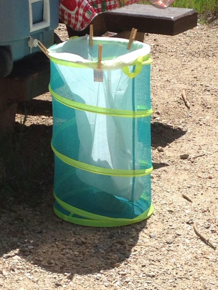 Pop-up hamper becomes camping trash can. Place a rock in the bottom of the hamper for windy areas. This hamper holds a 13 gal kitchen trash bag. Used clips to secure to hamper. Makes for fewer trips to park trash bin. Folds up compactly for packing!
