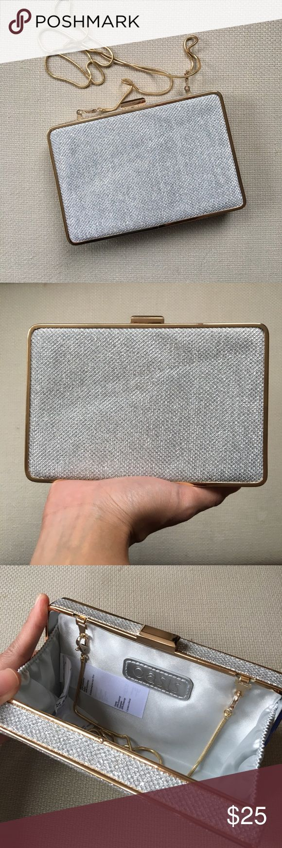 """OASIS Cheng Glitter Box Clutch in Silver New, barely used. Sparkly, textured finish. Fully lined gold-tone frame, clip-clasp fastening. Optional snake chain shoulder strap. Polyester; 4""""H / 7""""W / 1""""D Oasis  Bags Clutches & Wristlets"""