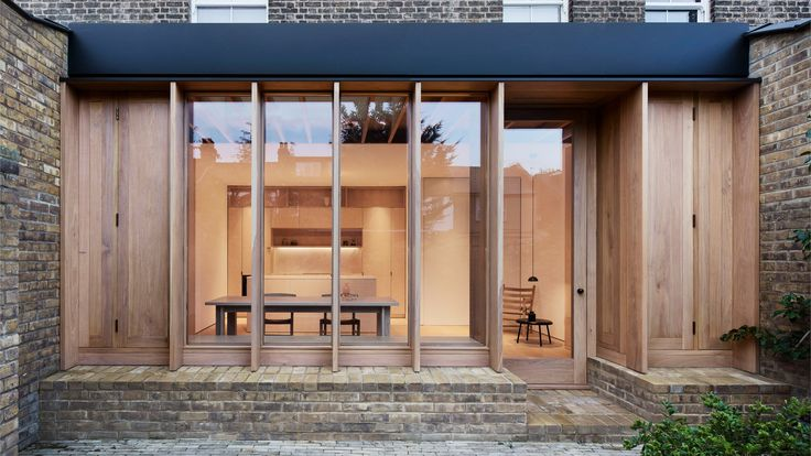 O'Sullivan Skoufoglou Architects has extended a typical terraced home in London, by adding a new timber-lined room that opens onto a brick-paved garden