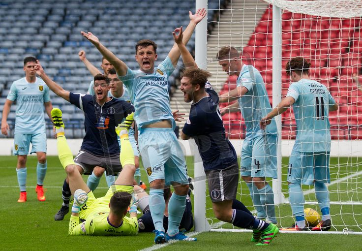 Queen's Park players celebrate the opening goal during the Ladbrokes League One game between Queen's Park and Livingston.