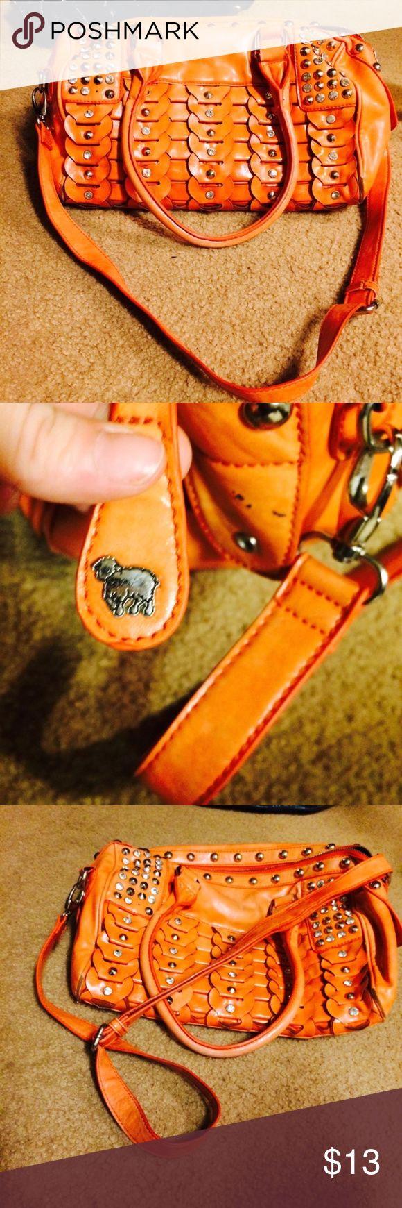 orange studded cross-body bag medium sized orange crossbody bag with multiple pockets on the lamb Bags