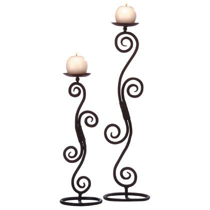 I love wrought iron & metal work -- for candle holders, mirrors, plant stands, bed frames, gates... etc!