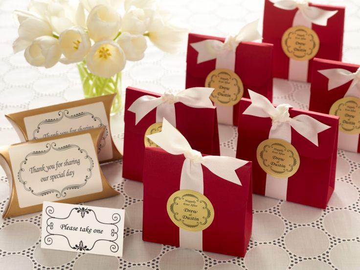 Beautiful way to wrap up wedding favors. So pretty and so easy to do. We found these lovely red boxes and filled them with yummy chocolates. After tying them off with some pretty white ribbon, we personalized an Avery  Embossed Round Label (41467) for a beautiful finishing touch.