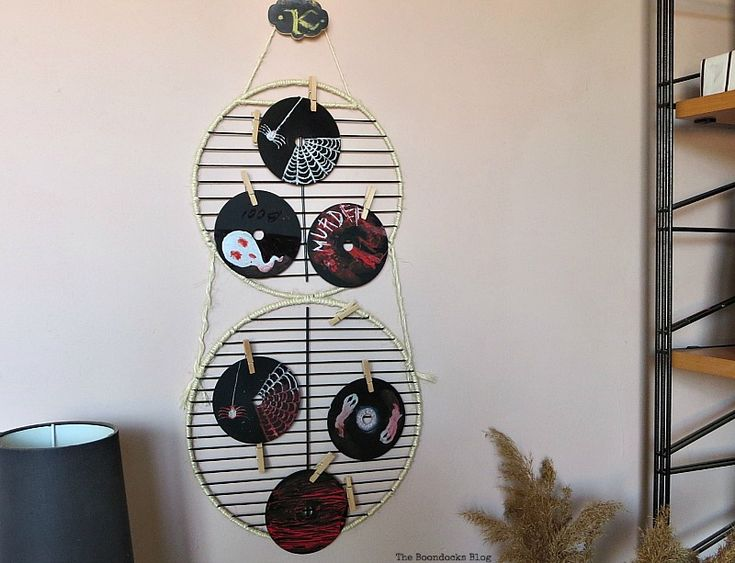 Photo display made with grill parts, Halloween Wall Unit Decor theboondocksblog.com