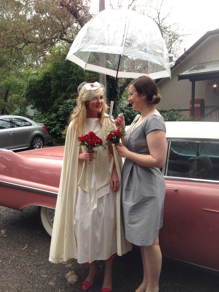 The very cute and quirky Tammy on her wedding day! #chateauwyuna #wedding #bride #groom #mrandmrs #weddingreception #brolly #rain #rainraingoaway #itsgoodluck