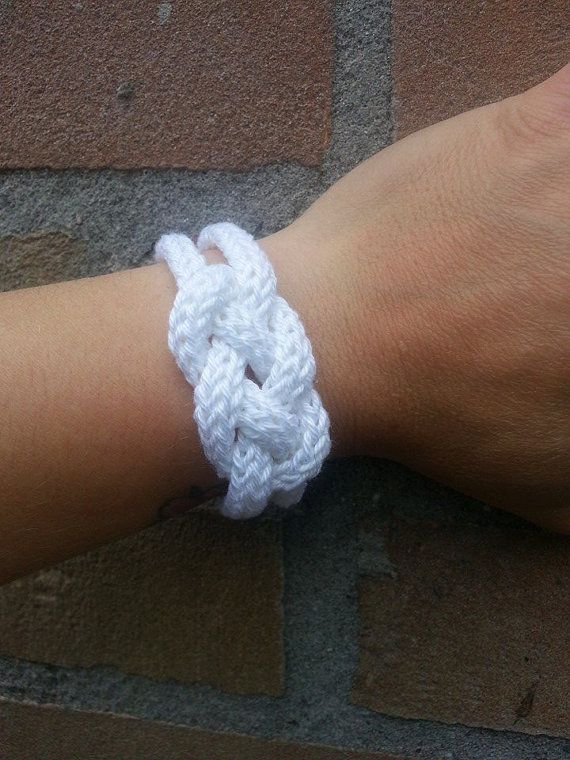 Handmade french knitted cotton bracelet with one white button.  The circumference is 21cm.