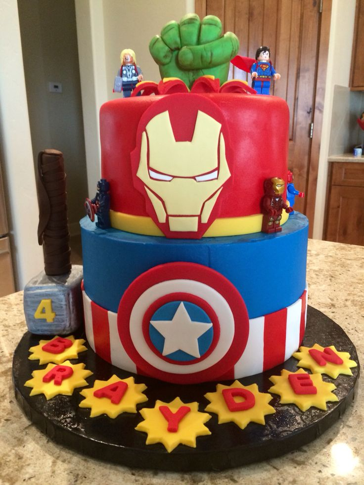 Avengers birthday cake with fondant hulk fist, iron man, captain America shield and Thor hammer. By Sweet Celebrations by Lori in SLC, UT