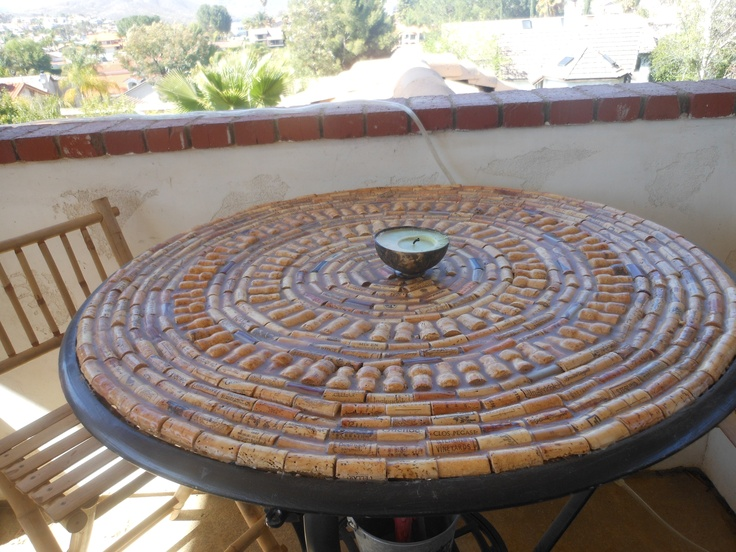 i made this table top with corks and resin