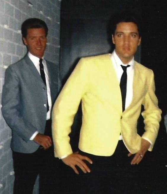 """Elvis Presley is pictured with Jimmy Kingsley outside his home at 565 Perugia Way in Bel Air, Los Angeles, CA during the making of """"Viva Las Vegas"""" (MGM) in July 1963. Elvis's 15th movie was filmed from July 9 to September 11,1963 and released on May 20, 1964. (Thnx to Terry Firman and Archie Lee respectively for the photo which they posted in the ELVIS PICTURES group on fb.)"""