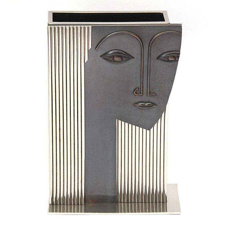 Art Deco Umbrella Stand. An asymmetrical base supports a chromed steel box fronted by a striking bronze face with chromed steel rod hair. In the style of Franz Hagenauer - circa 1960s.