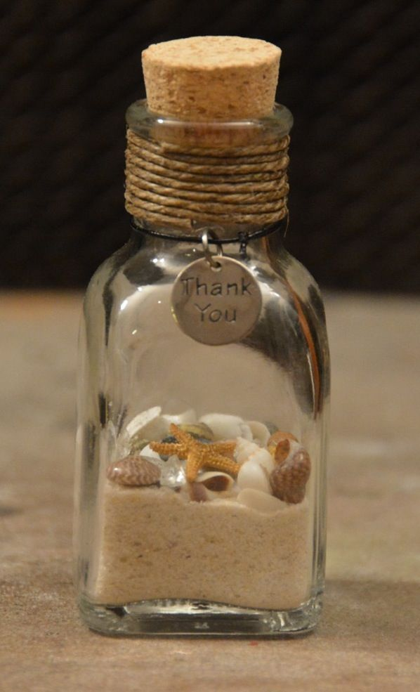 Beach Wedding Favors! Have the guests fill the bottle with sand from the beach after the wedding and have the shells out to create their own :)