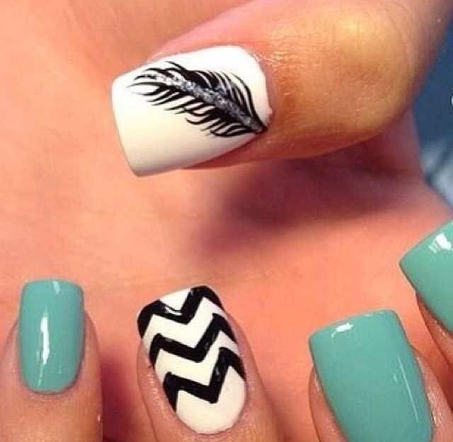 White and mint green nail design with feather