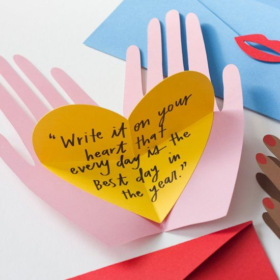 Make your Valentines 3D with this hand holding heart popup card.