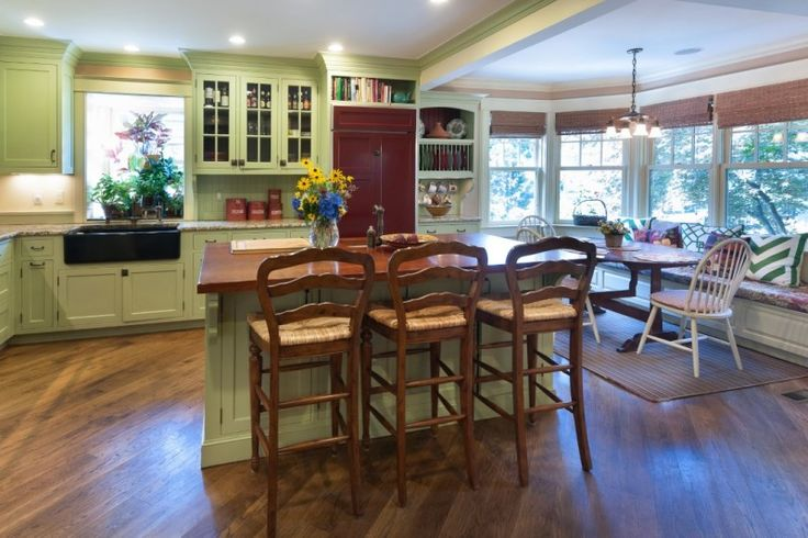 Cozy green kitchen with breakfast nook and banquette. A Lovely Old Lake House For Sale in Connecticut - Hooked on Houses